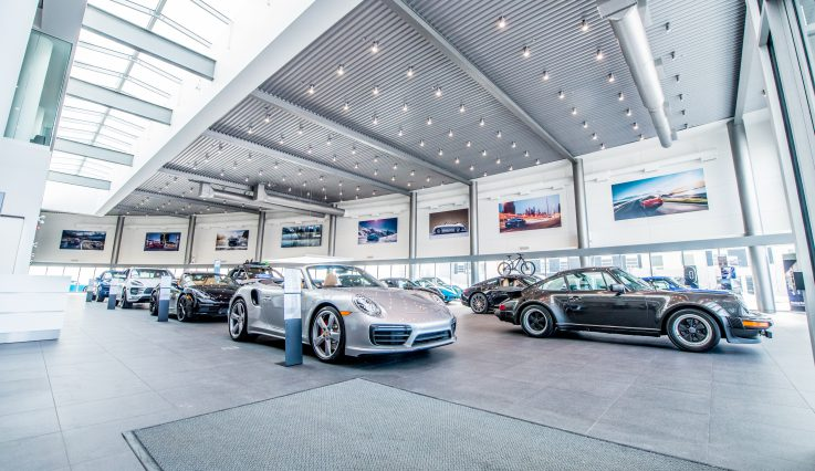 Showroom with cars at Porsche Centre Calgary.