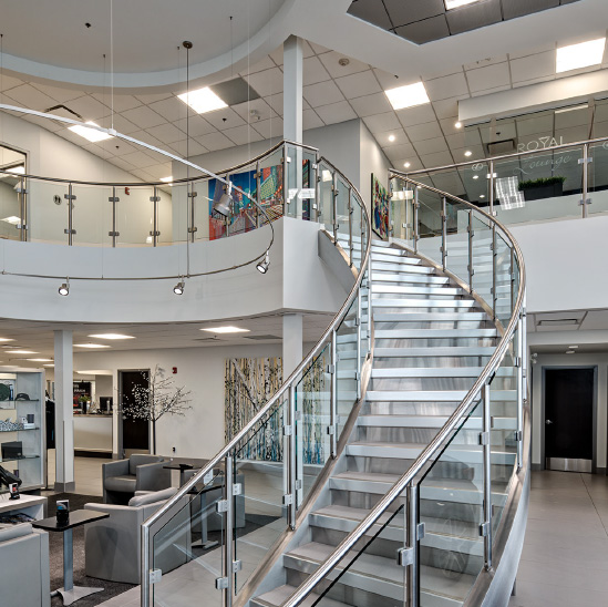 Staircase leading from showroom to offices at Lexus of Royal Oak.