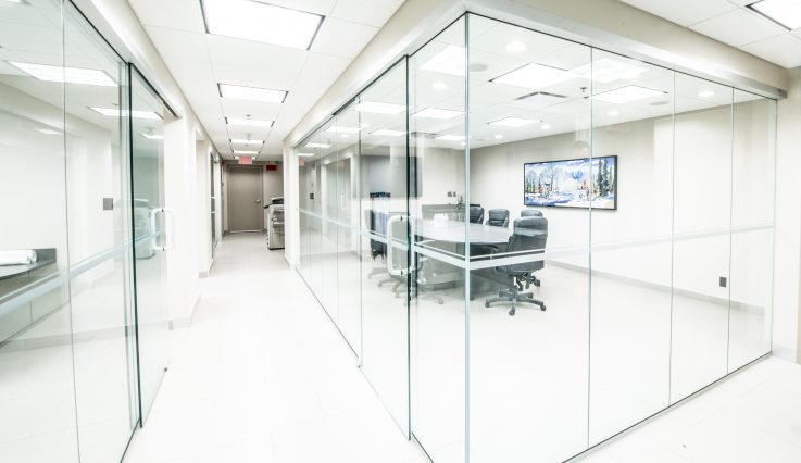 Offices with glass walls and boardroom at Barjac Construction.