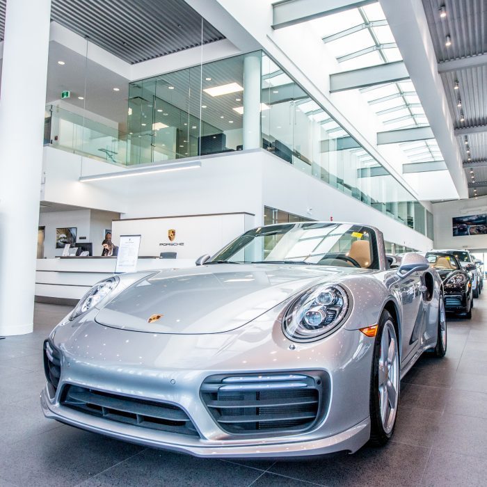 Porsche Centre Calgary showroom with multiple Porsche.