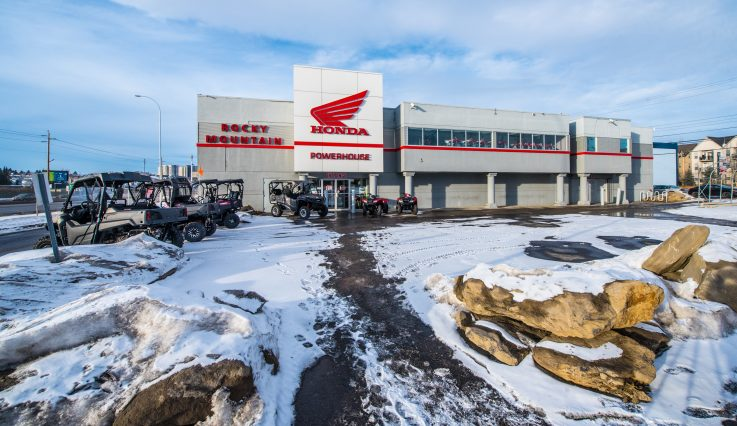 Exterior of building with snow on ground at Rocky Mountain Honda Powerhouse.